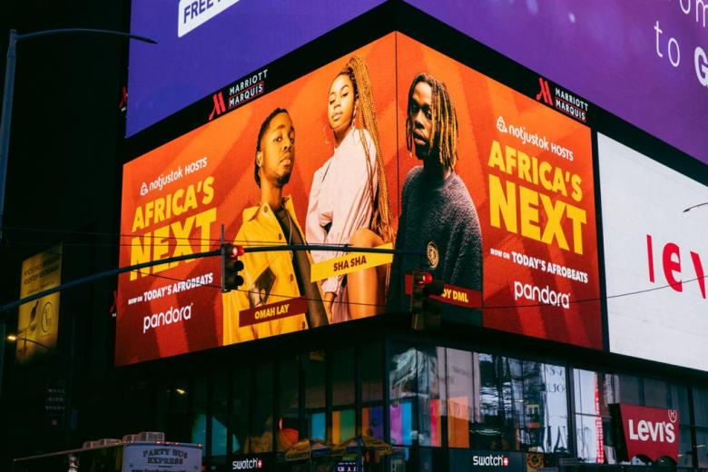 Fireboy, Omah Lay and Sha Sha Spotted on a Billboard in Times Square, New York