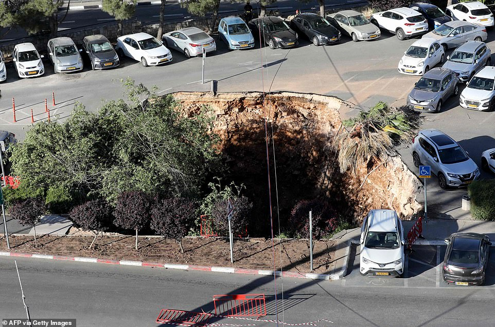 'What a nightmare': Watch sinkhole swallowing cars at parking lot in Jerusalem