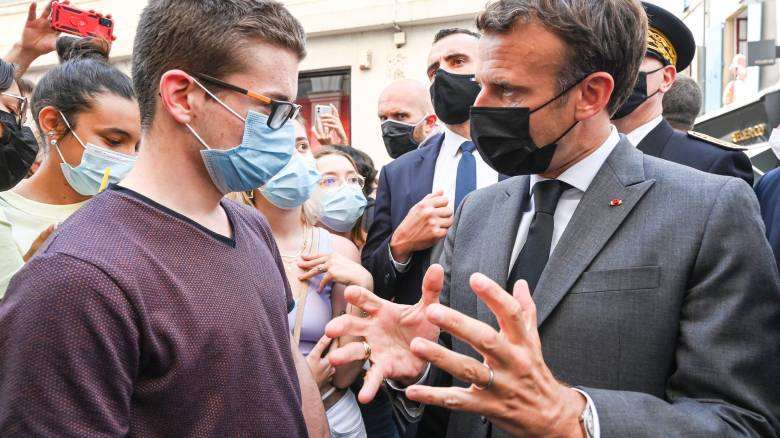 French President Emmanuel Macron slapped by bystander